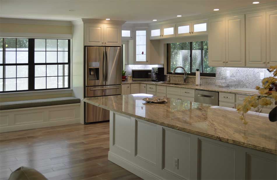 White Kitchen and Engineered Hardwood floor.