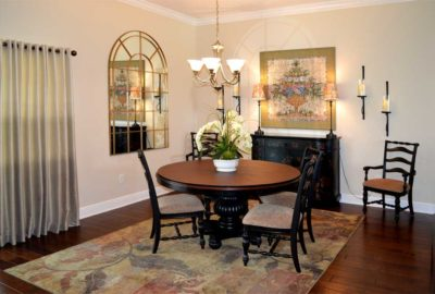 After Image of Dining room with former Living room rug.