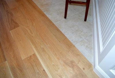 Seamless transition from Hardwood to Tile.