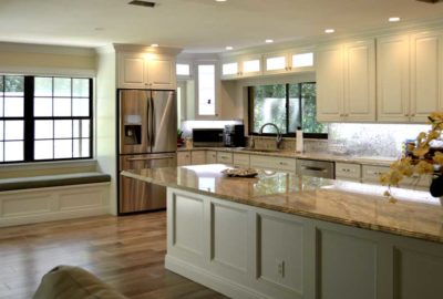 White Kitchen with Hardwood and Granite.