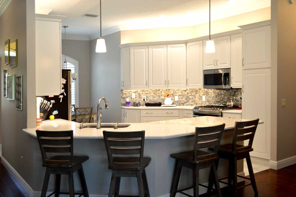 White Kitchen with Quartz counter tops.