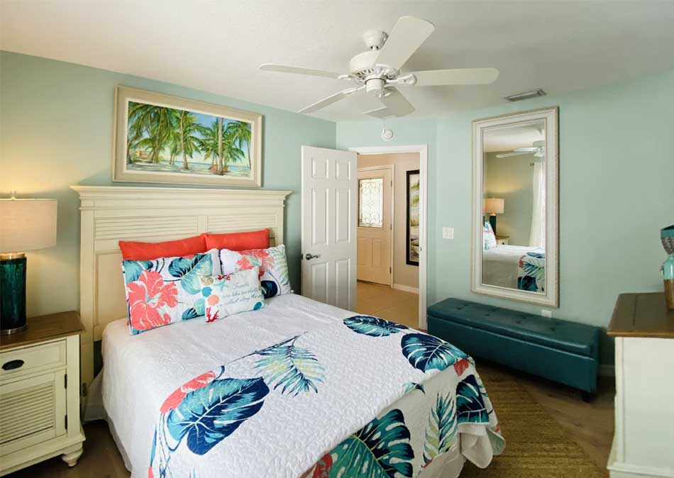 Bedding with Euro pillows (large square pillows) to place against the head board to pop the coral.