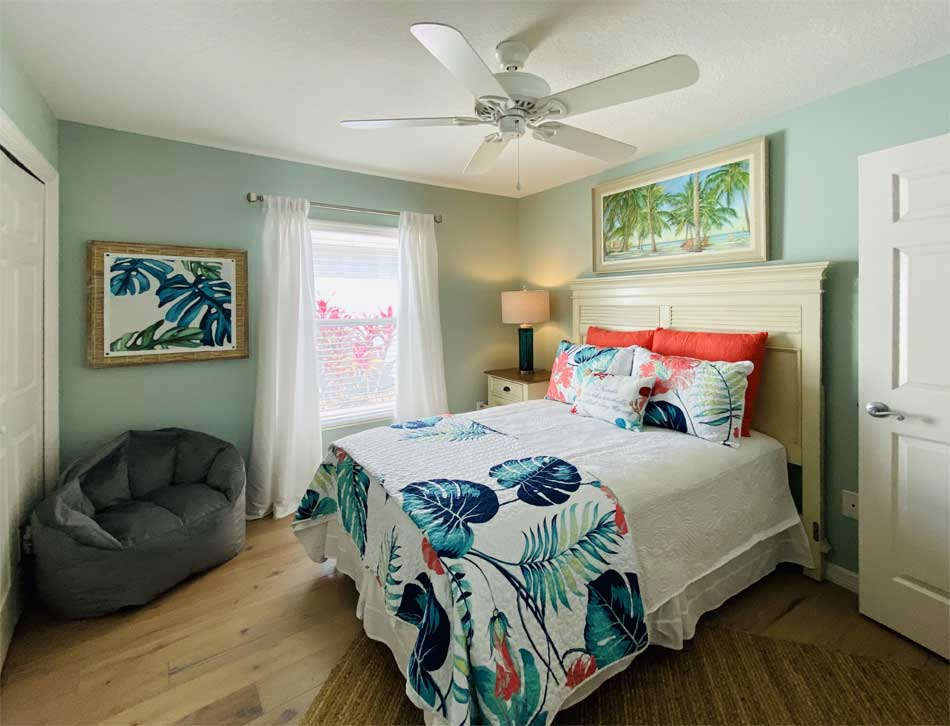 This model is a Bonifay and the guest room was specifically designed for the Florida fun, function, and color!