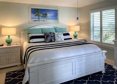 Master Bedroom of a Carrabelle Courtyard villa that is full of blue hues - Home Décor by Ruth Dyer.