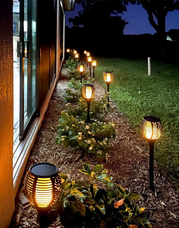 These are the torches at night. They flicker like a real flame. You cannot tell they are solar - Interior Design - Home Décor by Ruth Dyer.