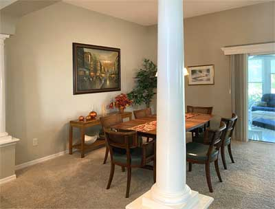 Begonia dining room with the column - Interior Design - in the Villages of Florida.