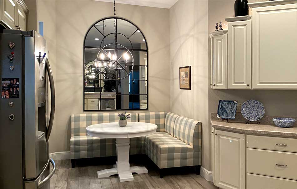 The eat-in kitchen with the banquette - Interior Design - in the Villages of Florida.