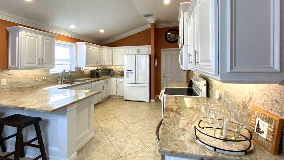 Windows and the wine refrigerator - Interior Design - Home Décor by Ruth Dyer.